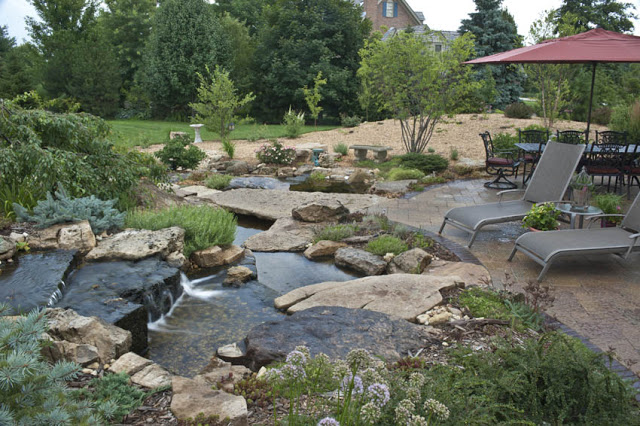 Entertain guests for dinner on the patio, or cozy up next to someone special in the lounge chairs by this water feature