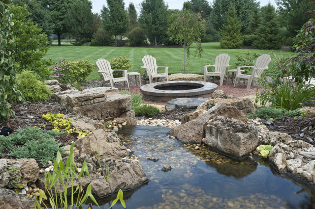 This water feature streams its way toward a fire pit with seating