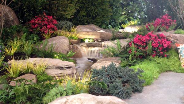 Backyard Waterfalls Ideas deck and patio poolside waterfall Backyard Waterfall By Arbor Ridge