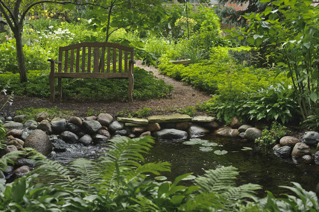Lush greenery and a soothing water garden help cool the climate