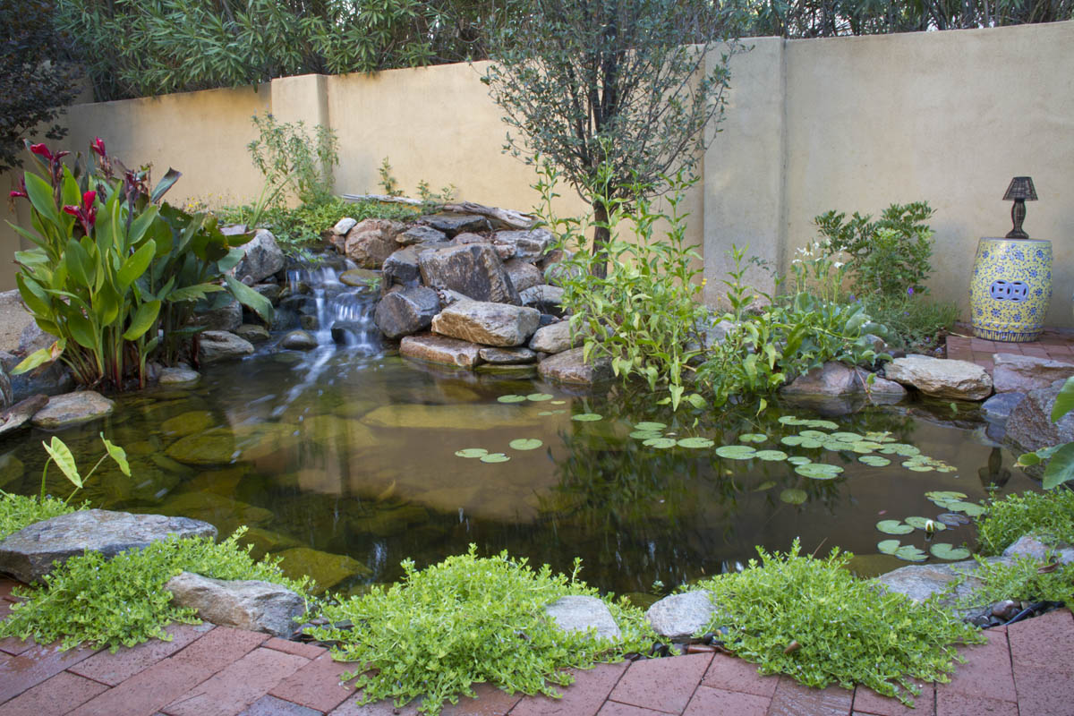 Landscape edging ideas for water features aquascape inc for Garden pond edging