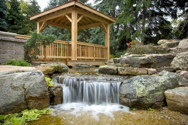 Who wouldn't love this floating deck overlooking a waterfall that cascades into a pebble beach?