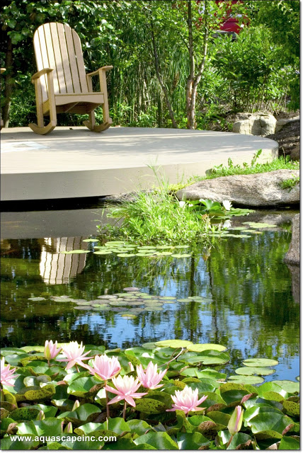 Settle into a comfy rocker and enjoy the view of your water feature from your deck!