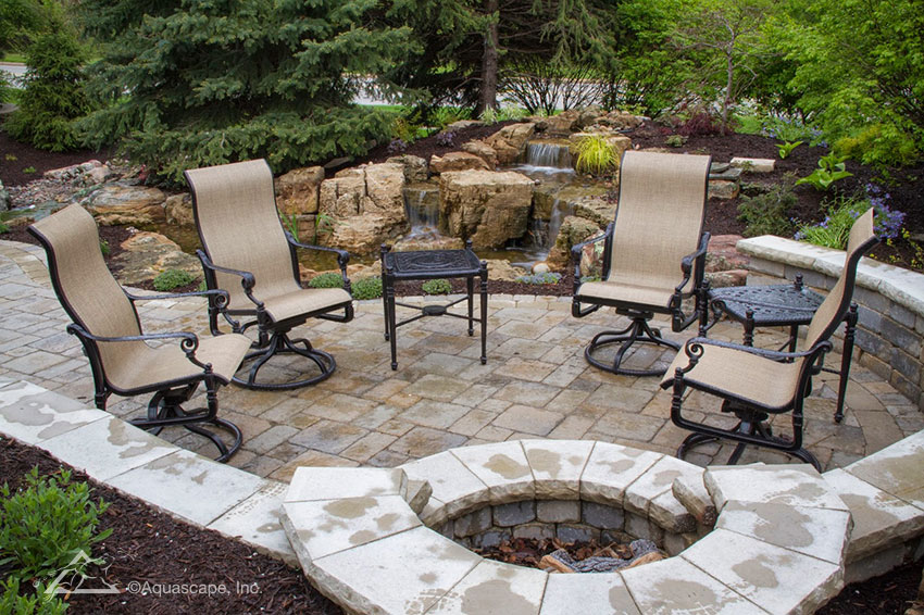 Not only can these homeowners enjoy a fire but can also listen to the sounds of the waterfalls in the background as they relax on their patio.