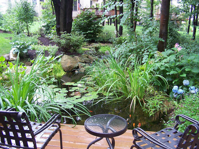 A cozy table for two provides intimate seating for romantic dinners by the pond.