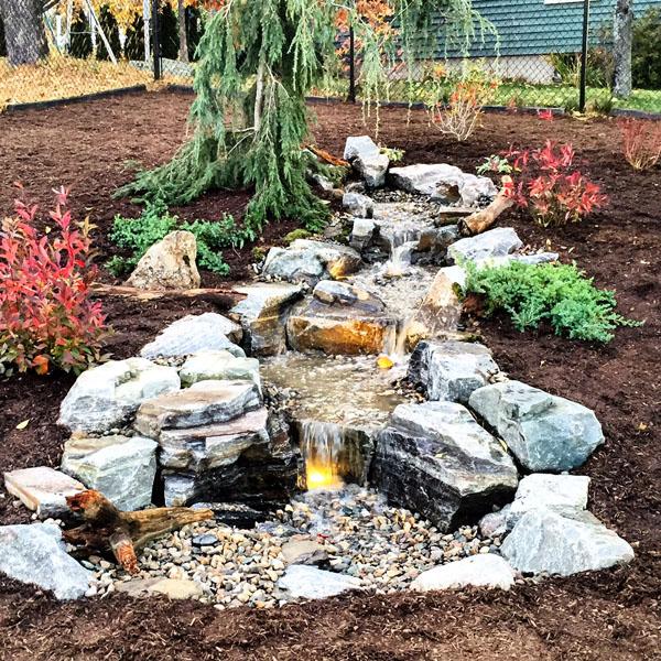 stunning garden waterfall | 7 Beautiful Backyard Waterfall Ideas - Aquascape, Inc.