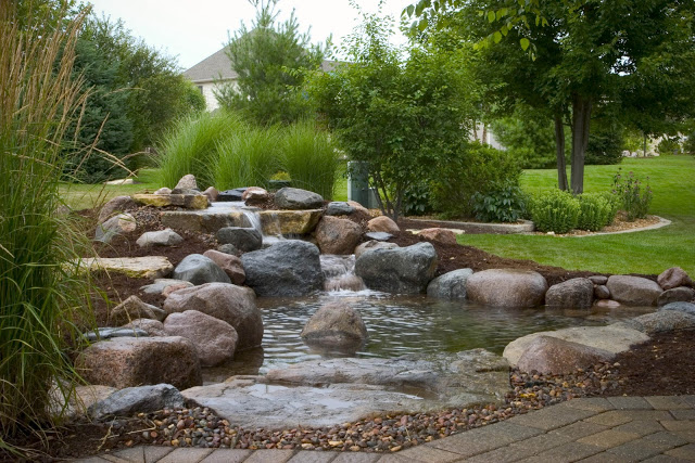 Strategic use of the surrounding landscape was considered when designing this pond and waterfall.