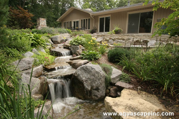 The upper falls and pond in this backyard cascade into another waterfall, taking advantage of the natural slope.