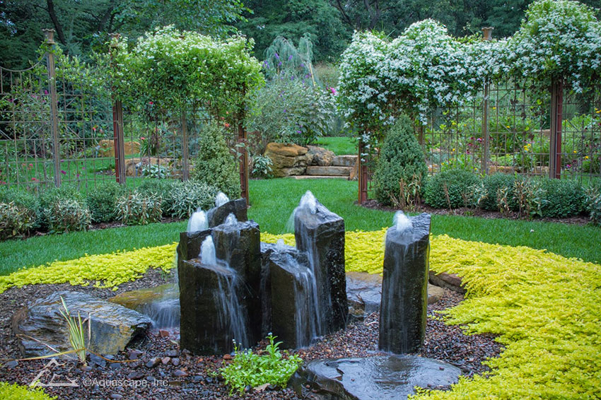 A group of basalt columns take center stage in this lush garden.