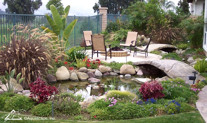 Backyard Pond with Bridge to Fire Pit