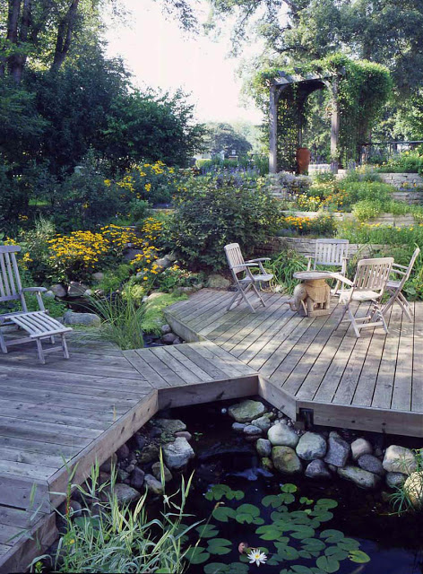 This unique deck dissects the pond, providing multiple viewing areas to enjoy the abundant aquatic plants and surrounding landscape.