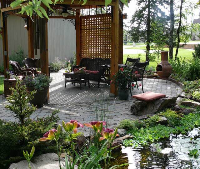 What a pleasure to have a vacation-like dining spot and pond in your own backyard.