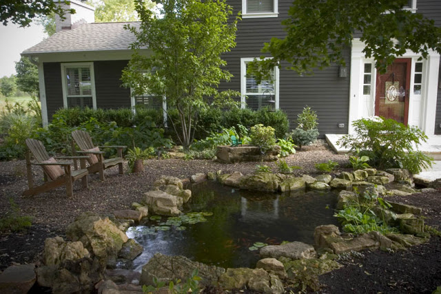 Adirondack chairs are a popular choice among pond owners. This couple placed the pond front and center, as opposed to tucking it away in the backyard.