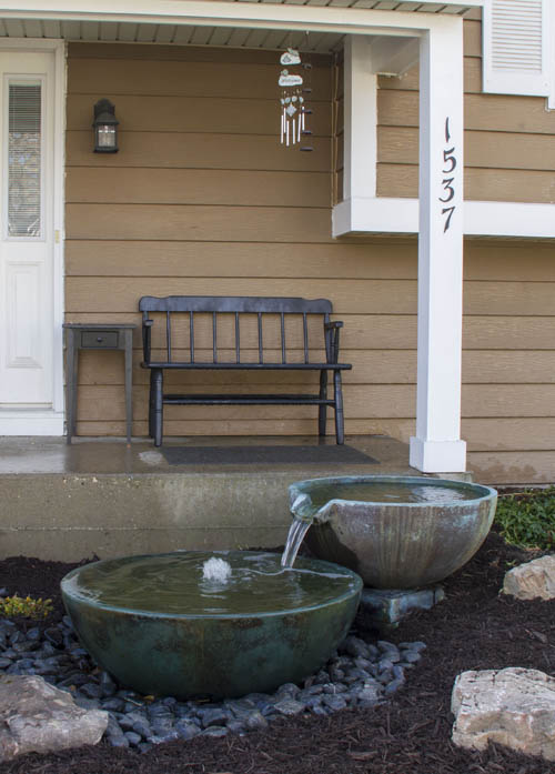 Spillway bowls at front entrance of home