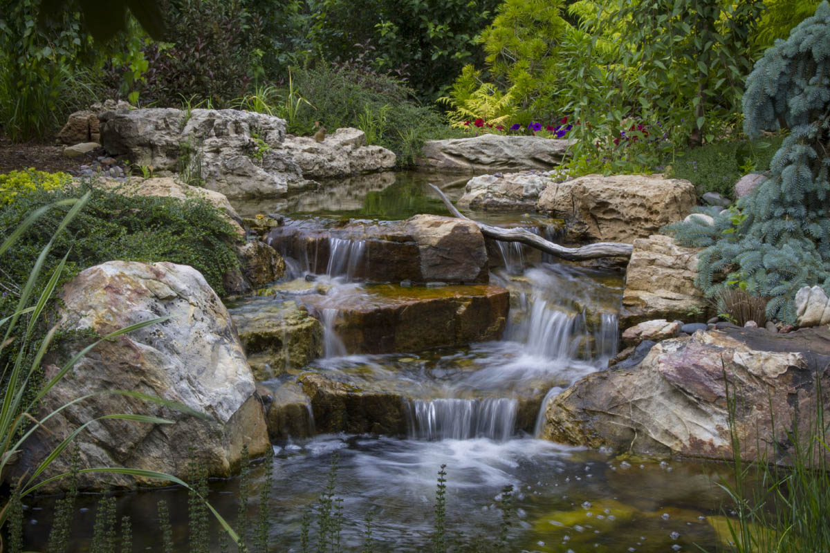 Rugged Waterfalls Add Soothing Sounds to Suburban Backyard