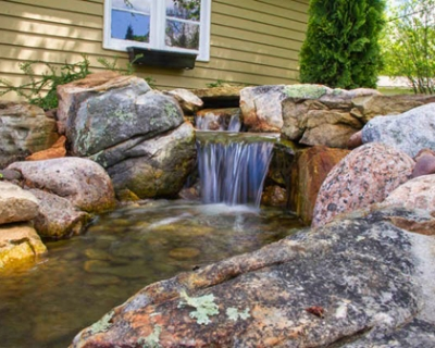 How A Pondless Waterfall Created An Outdoor Retreat