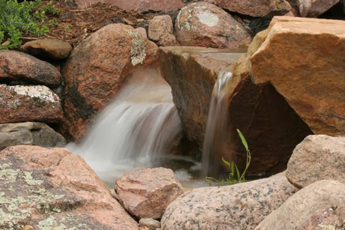 Rocks lend an architectural element to a waterfall and should be chosen carefully. Often, a pond installer will re-position a boulder several times until the right look is achieved.