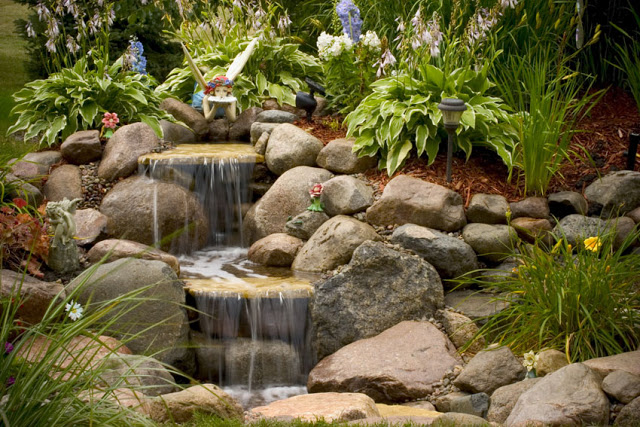 A bit of whimsy lends itself to this smaller waterfall. Imagine a child's delight upon discovering the tiny fairy.