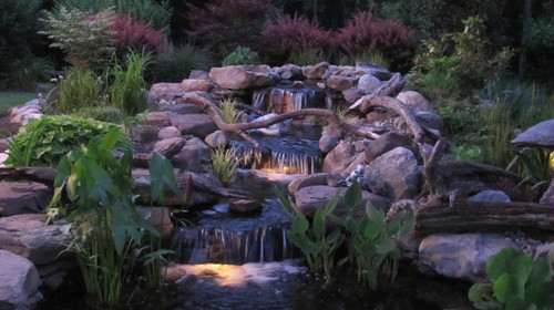 Beautiful nighttime waterfall setting! An eclectic Baltimore, MD Landscape design by Premier Ponds