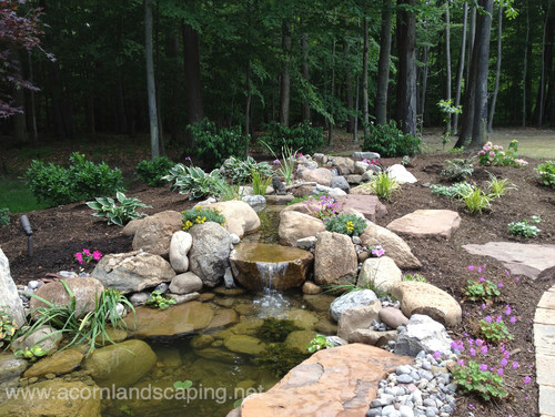 Lovely waterfall design by New York Landscape Architect Acorn Landscaping
