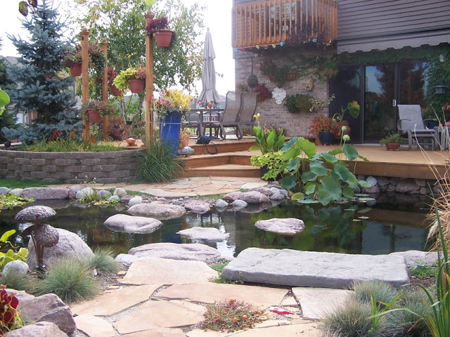 A balcony and lower deck provide great views of this water garden.