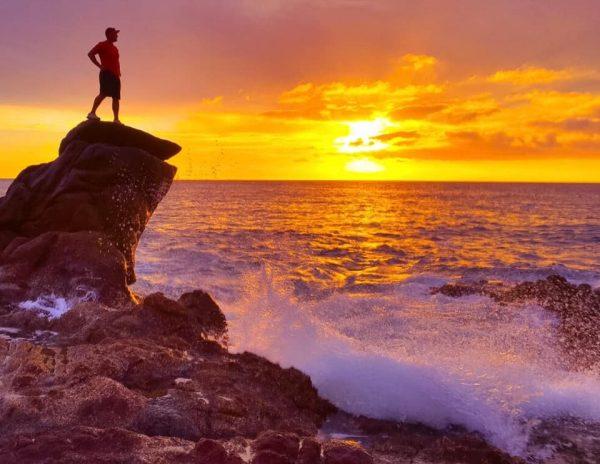 Man on Rock Near Wave