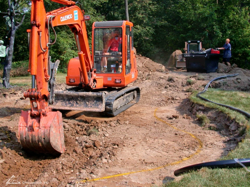 Large Pond Project Excavation with Equipment