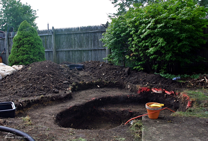 Excavating Plant Shelves in a Backyard Pond